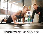 fitness woman exercising with... | Shutterstock . vector #345372770