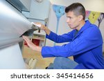 young man loading new roll into ... | Shutterstock . vector #345414656