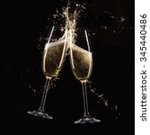 glasses of champagne with splash | Shutterstock . vector #345440486