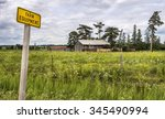 A Farm Equipment Sign At The...