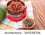 chili papper on wooden | Shutterstock . vector #345538706
