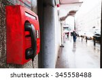 Red Payphone On The Wall....