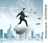 businessman climbing thecloud... | Shutterstock . vector #345559640