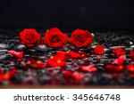 Stock photo still life with three red rose petals and therapy stones 345646748