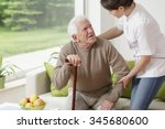 young woman helping old man to... | Shutterstock . vector #345680600