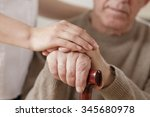 young woman and old man holding ... | Shutterstock . vector #345680978