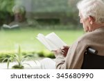 old man on wheelchair reading a ... | Shutterstock . vector #345680990