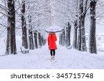 Girl With Umbrella Walking On...