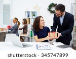 young businessman giving his... | Shutterstock . vector #345747899