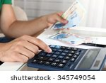 calculating money  close up | Shutterstock . vector #345749054