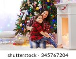 happy mother and daughter... | Shutterstock . vector #345767204