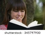 young woman shocked by reading... | Shutterstock . vector #345797930