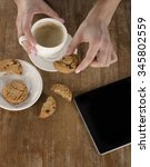 woman hands with coffee and... | Shutterstock . vector #345802559