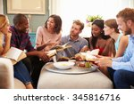 Group Of Friends Taking Part In Book Club At Home
