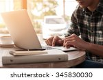 businessman using laptop with... | Shutterstock . vector #345830030