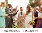 guests throwing confetti over... | Shutterstock . vector #345832124