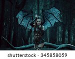 girl vampire  a demon with bat... | Shutterstock . vector #345858059