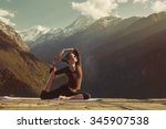 young woman doing yoga exercise ... | Shutterstock . vector #345907538