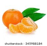 Ripe Mandarin With Leaves Clos...