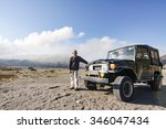 Small photo of BROMO, INDONESIA - NOVEMBER 17: A local posing at summit of penanjakan with a sunrise view of mount bromo in the background. Tourism is one of the main income for local 17 November 2015