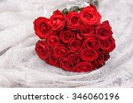 Stock photo bouquet red roses on silk 346060196
