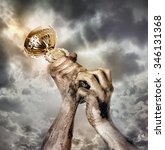 gold cup in dirty hands on sky... | Shutterstock . vector #346131368