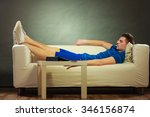 young man relaxing on couch ... | Shutterstock . vector #346156874