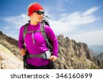 Woman Hiking With Backpack In...
