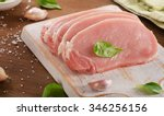 pork chops on a cutting board.... | Shutterstock . vector #346256156