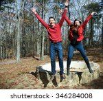 Attractive young couple jumping for joy. - stock photo