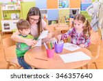 preschool teacher with two ... | Shutterstock . vector #346357640