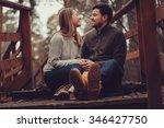 happy loving couple enjoying... | Shutterstock . vector #346427750