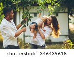 parents with baby enjoying... | Shutterstock . vector #346439618