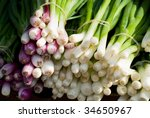 bundles of green onions with...
