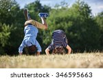 Small photo of Two boys making a somersault and having fun at the park