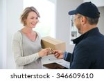 woman receiving package from... | Shutterstock . vector #346609610