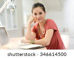 young woman working on laptop ... | Shutterstock . vector #346614500