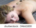 female model lying on stone... | Shutterstock . vector #34661830