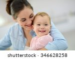 portrait of mother cuddling her ... | Shutterstock . vector #346628258