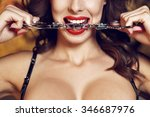 Stock photo sexy woman bite handcuffs red lips bdsm 346687976