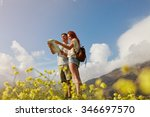 young couple looking at map... | Shutterstock . vector #346697570