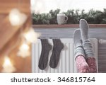 woman warming up with feet on... | Shutterstock . vector #346815764