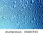 Close-up of blue water bubbles to be used as an abstract background - stock photo