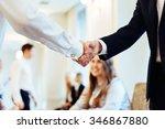 Small photo of Business men hand shake