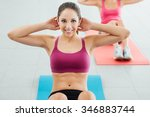 sporty young girl at the gym... | Shutterstock . vector #346883744