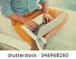 young man working on laptop... | Shutterstock . vector #346968260