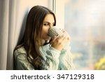 woman drinking coffee near... | Shutterstock . vector #347129318