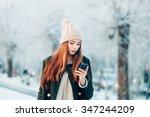 woman in winter park talking...   Shutterstock . vector #347244209