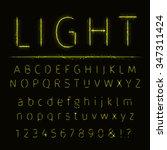 alphabet of yellow on dark... | Shutterstock .eps vector #347311424