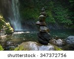 Piles Up Pebble Stones In A...